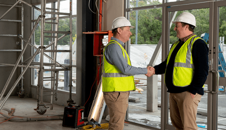 Chad Rapsey shaking clients hand on site