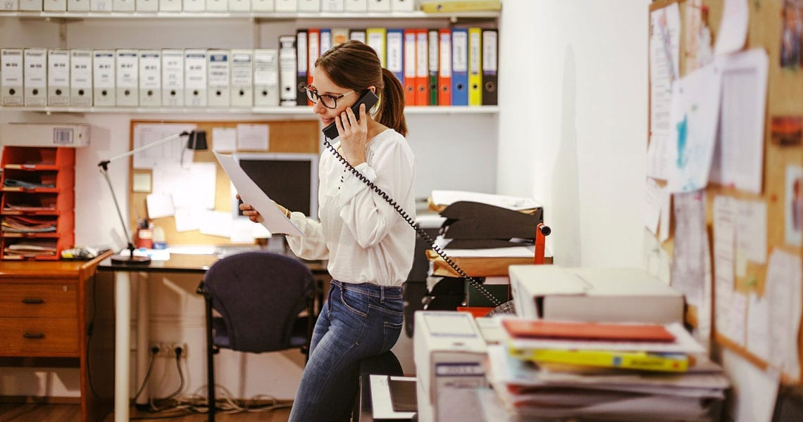 Lawyer At Phone In Her Office.